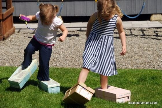 20 Unique Activities to Do While Your Family is in Quarantine - Kids doing big foot races with boxes