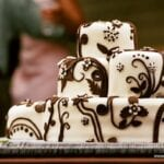 Brown and White Whimsical Flower Wedding Cake