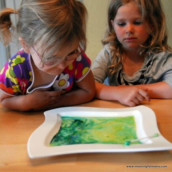 Kids Looking at colored milk