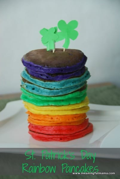 These rainbow pancakes with 4 leaf clovers stuck into the top are a perfect breakfast for St. Patricks day. The pancakes are red, orange, yellow, green, blue, and violet.