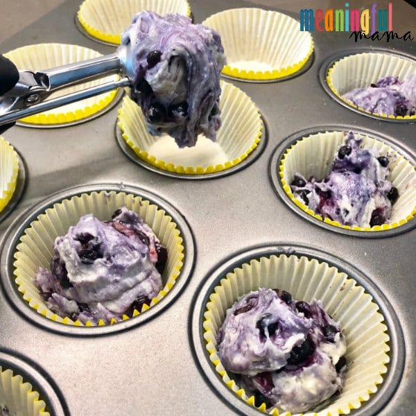 Scooping Blueberry Muffin Mix into Muffin Tin