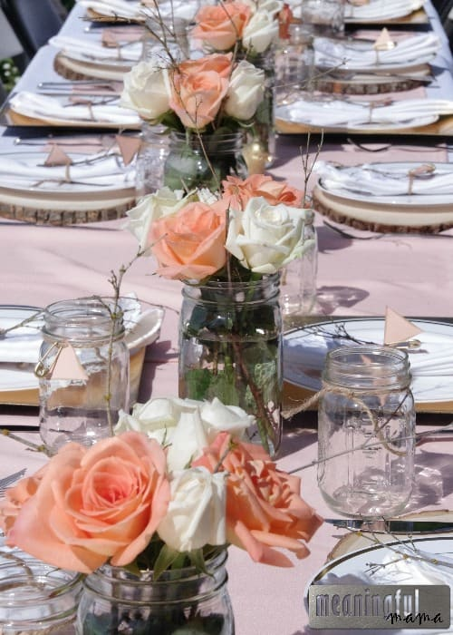 peach and gold outdoor baby shower table setting