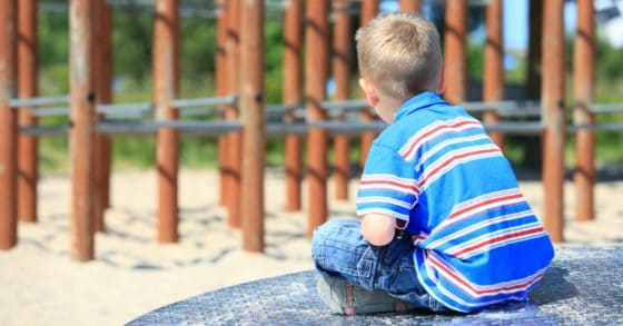 sad child on playground with victim mentality