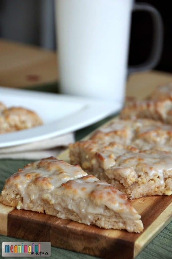 cinnamon sour cream scones by coffee cup