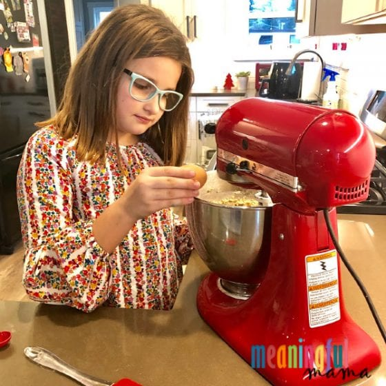 little girl baking with a mixer