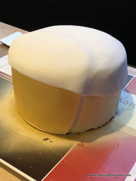 Covering Golden Ninja Cake with Fondant