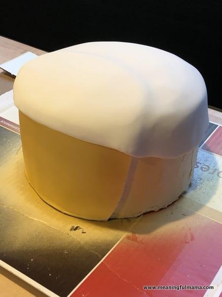Covering Golden Ninja Cake with Fondant