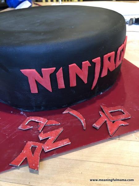 Red Ninjago Font on Black Cake