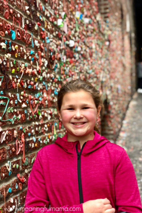 Girl in Front of Gum Wall in Seattle