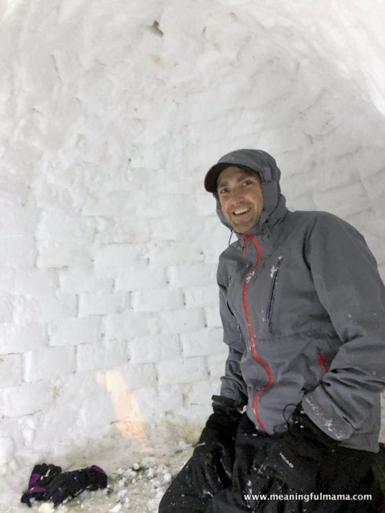 man inside igloo