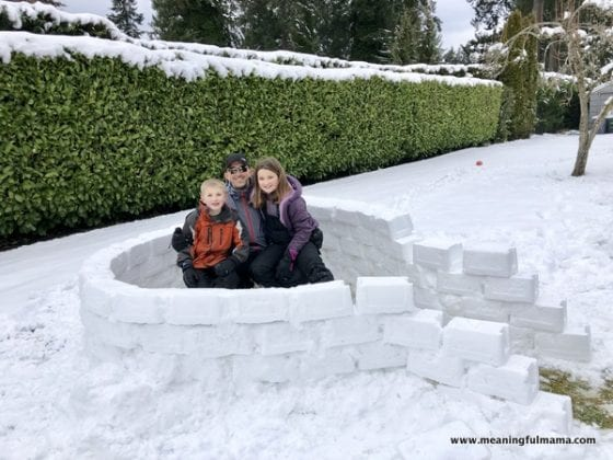 dad and kids building an igloo