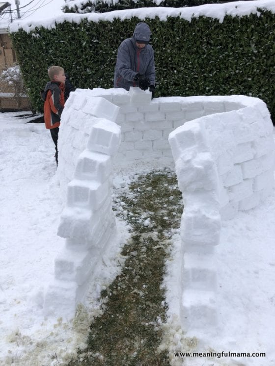 dad building an igloo with his son