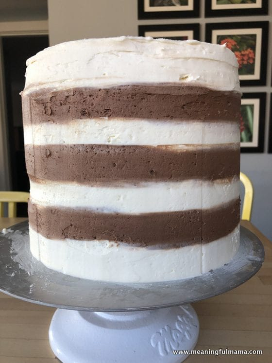striped chocolate and plain buttercream frosting on cake