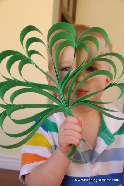 boy holding a Four Leaf Clover Paper Craft