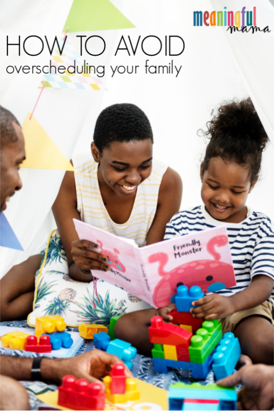 African American Family Relaxing and Reading with Kids