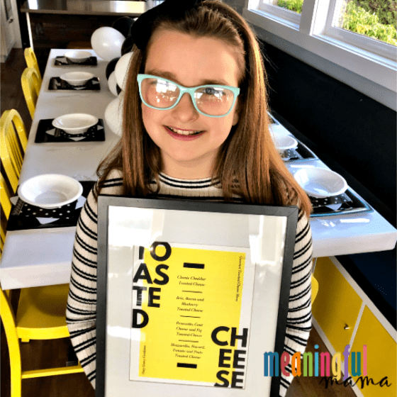 Girl Holding a Gourmet Grilled Cheese Menu