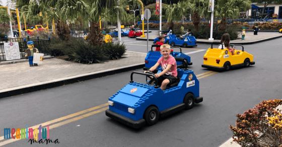 boy in blue car at Legoland driving school