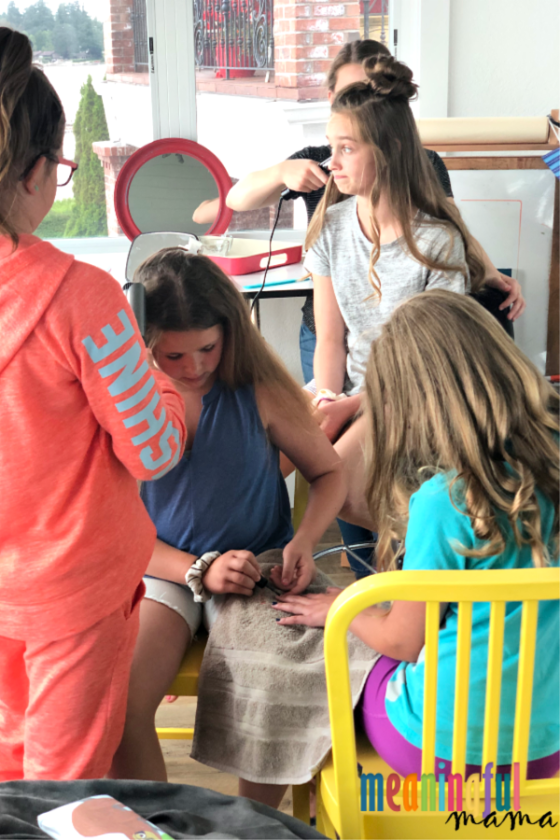 tween girls doing hair at spa party