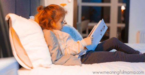 Girl Reading in Bed to Help with Bedtime Routine