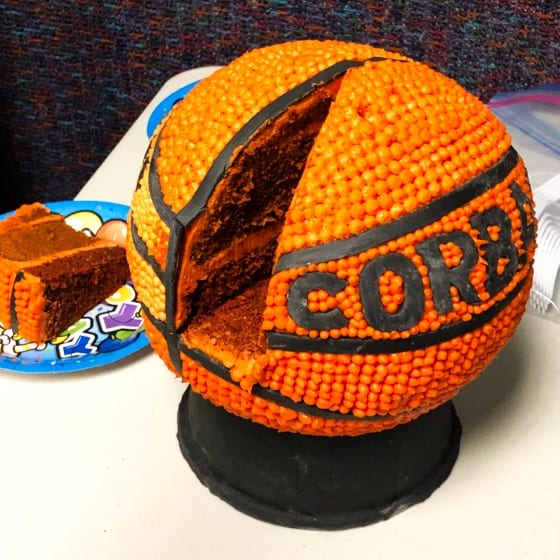 basketball cake with slice cut out