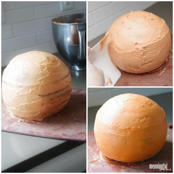 frosting a sphere cake to become a basketball cake