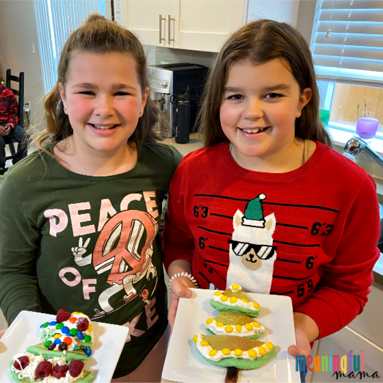 Girls Holding these Easy and Adorable Christmas Tree Pancakes