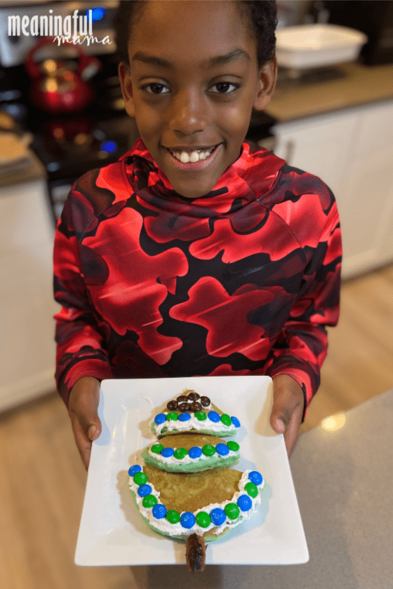 Boy Holding easy and adorable Christmas tree pancakes