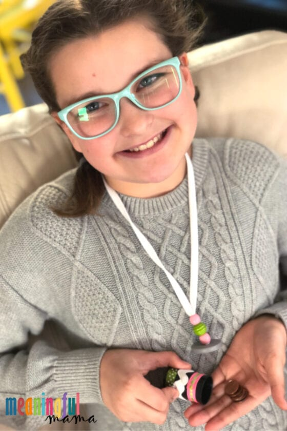 Girl Wearing DIY Keepsake Holder Necklace Craft that Teaches Perseverance